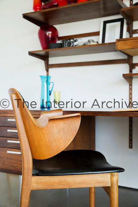 In the sitting room, plywood armchairs are vintage pieces by Thonet and the desk is Scandinavian mid-century.