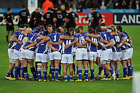 The Namibia team huddle together prior to kick-off. Rugby World Cup Pool C match between New Zealand and Namibia on September 24, 2015 at The Stadium, Queen Elizabeth Olympic Park in London, England. Photo by: Patrick Khachfe / Onside Images