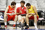 Spain's Victor Claver (l) and Felipe Reyes (r) with the ex player Jorge Garbajosa (c) now member of the technical corp in the national basket team during training session.July 24,2012(ALTERPHOTOS/Acero)