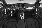 Stock photo of straight dashboard view of 2017 BMW 2-Series M230i 2 Door Convertible Dashboard
