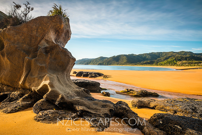 Rock formations on pristine and empty beach in Totaranui on Abel Tasman Coastal Track, Abel Tasman National Park, Nelson Region, South Island, New Zealand