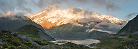 Moody sunrise with Mueller Lake, Mount Sefton and Footstool emerging from clouds, Aoraki Mount Cook National Park, UNESCO World Heritage Area, Mackenzie Country, South Island, New Zealand, NZ