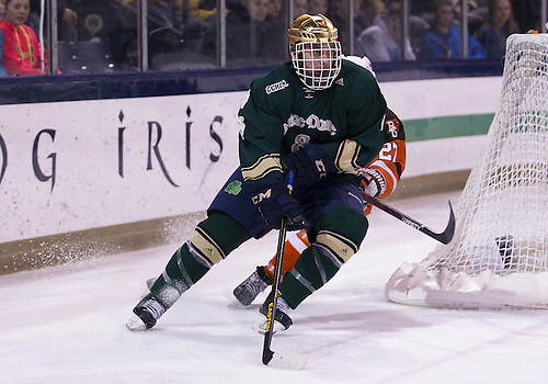 March 02, 2013:  Notre Dame defenseman Sam Calabrese (8) skates with the puck during NCAA Hockey game action between the Notre Dame Fighting Irish and the Bowling Green Falcons at Compton Family Ice Arena in South Bend, Indiana.  Notre Dame defeated Bowling Green 4-1.