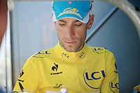 Vincenzo Nibali (ITA/Astana) signing an autograph right before he needs to go to doping control<br /> <br /> 2014 Tour de France<br /> stage 12: Bourg-en-Bresse - Saint-Eti&egrave;nne (185km)
