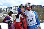Lilla Gidlow, 65, and Rolf Funk, age TK, check the score board for their race times Sunday at the Masters race in Aspen, CO. Michael Brands for The New York Times.