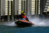 13-MDonny Allen, 13-M waves to his fans after finishing the Top O' Michigan Marathon.    (Outboard Runabout)