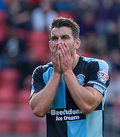 Matt Bloomfield of Wycombe Wanderers can't believe a Referee decision during the Sky Bet League 2 match between Leyton Orient and Wycombe Wanderers at the Matchroom Stadium, London, England on 19 September 2015. Photo by Andy Rowland.