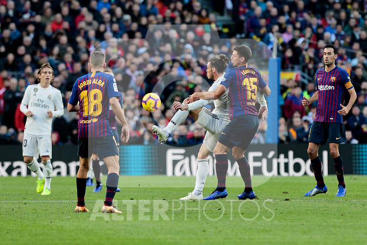 FC Barcelona's Jordi Alba (L) and Clement Lenglet (R) and Real Madrid's Gareth Bale during La Liga match between FC Barcelona and Real Madrid at Camp Nou Stadium in Barcelona, Spain. October 28, 2018. (ALTERPHOTOS/A. Perez Meca)