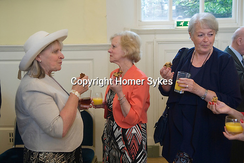 Jankyn Smyth Cake and Ale ceremony at the Guildhall,  Bury St Edmunds Suffolk 2015. Guests enjoy cake, ale or orange juice in the Guildhall in celebration of the towns benefactor Jankyn Smyth ( died 1491 )