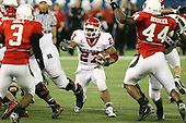 January 5th, 2008:  Rutgers running back Ray Rice (27) finds a hole as Ball State defenders B.J. Hill (3) and Cortlan Booker (44) close in during the second quarter of the International Bowl at the Rogers Centre in Toronto, Ontario Canada...Rutgers defeated Ball State 52-30.  ..Photo By:  Mike Janes Photography