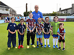 Ipswich Town Manager Mick McCarthy with Drogheda United mascots Nathan Hynes, Dylan Carolan, Nathan Barnett, Liam Greenslade, jayden Walsh McDonnell, Kayleigh Walsh McDonnell and Nathan Brady at the Drogheda United V Ipswich Town match at United Park. Photo:Colin Bell/pressphotos.ie