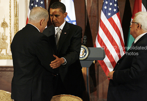 New York, NY - September 22, 2009 -- United States President Barack Obama (C) shakes hands with Israeli Prime Minister Benjamin Netanyahu as Palestinian President Mahmoud Abbas (R) looks on at a trilateral meeting at the Waldorf Astoria Hotel in New York City on Tuesday, September 22, 2009.   .Credit: John Angelillo / Pool via CNP