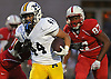 Massapequa No. 44 Sal Americo fights for rushing yards during a Nassau County Conference I varsity football game against host Freeport High School on Friday, September 25, 2015<br /> <br /> James Escher