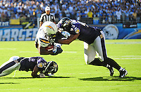 Sep. 20, 2009; San Diego, CA, USA; Baltimore Ravens defensive end (93) Dwan Edwards tackles San Diego Chargers running back (43) Darren Sproles at Qualcomm Stadium in San Diego. Baltimore defeated San Diego 31-26. Mandatory Credit: Mark J. Rebilas-