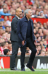 Josep Guardiola manager of Manchester City and Jose Mourinho manager of Manchester United during the Premier League match at Old Trafford Stadium, Manchester. Picture date: September 10th, 2016. Pic Simon Bellis/Sportimage