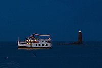 The M/V Thomas Laighton cruises around Portsmouth Harbor and past Whaleback Lighthouse on a summer evening