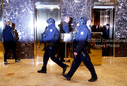Security agents walk in the lobby of the Trump Tower, while United States President-elect Donald Trump holds meetings on top floors of the building, November 21, 2016, in New York, New York.<br /> Credit: Aude Guerrucci / Pool via CNP