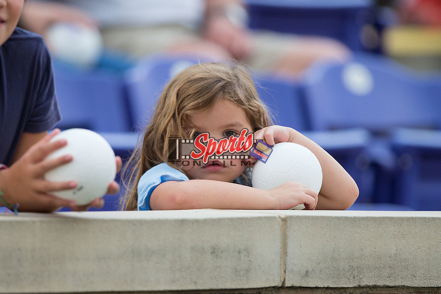 A young High Point Panthers fan holds onto a mini soccer ball as she gets ready to watch the match against the VMI Keydets at Vert Track, Soccer & Lacrosse Stadium on September 5, 2015 in High Point, North Carolina.  (Brian Westerholt/Sports On Film)