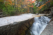 "A section of a rocky gorge just above the ""other"" Pitcher Falls, located on the South Fork of the Hancock Branch in the White Mountains, New Hampshire USA during the autumn months."