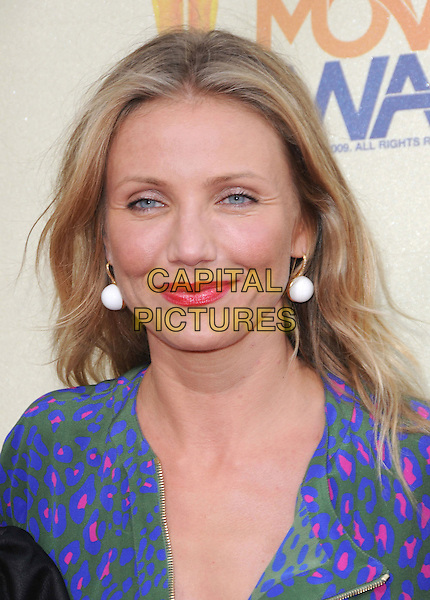 CAMERON DIAZ.The 2009 MTV Movie Awards held at Universal Ampitheatre  in Universal City, California, USA..May 31st, 2009 .headshot portrait white earrings  red lipstick blue green pink pattern purple .CAP/DVS.©Debbie VanStory/Capital Pictures.