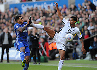 Cardiff City's Nathaniel Mendez-Laing nearly collides with Swansea City's Kyle Naughton high boot <br /> <br /> Photographer Ian Cook/CameraSport<br /> <br /> The EFL Sky Bet Championship - Swansea City v Cardiff City - Sunday 27th October 2019 - Liberty Stadium - Swansea<br /> <br /> World Copyright © 2019 CameraSport. All rights reserved. 43 Linden Ave. Countesthorpe. Leicester. England. LE8 5PG - Tel: +44 (0) 116 277 4147 - admin@camerasport.com - www.camerasport.com