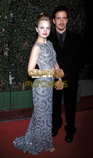 MENA SUVARI.Dreamworks Party.Ref: 9469.long dress, beaded, sequinned, silver, grey, small bag, full length.sales@capitalpictures.com.www.capitalpictures.com.©Capital Pictures