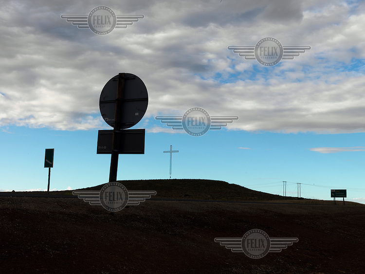 Roadsigns and a cross silhouetted along the M1 highway in the Free State.