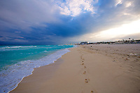 Footprints in the sand on Cancun Beach
