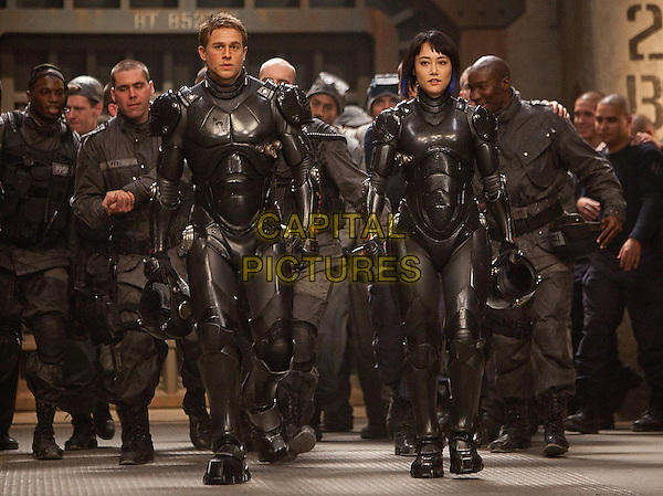 Charlie Hunnam &amp; Rinko Kikuchi<br /> in Pacific Rim (2013) <br /> *Filmstill - Editorial Use Only*<br /> CAP/FB<br /> Image supplied by Capital Pictures
