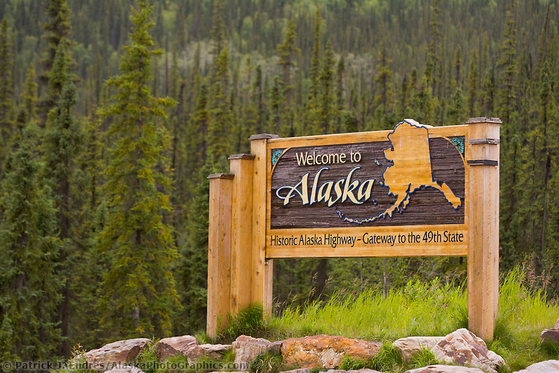 United States, Alaska/Canada border sign. Yukon Territory and Alaska