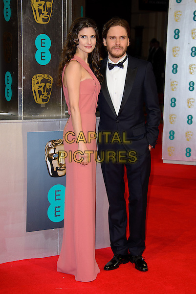 LONDON, ENGLAND - FEBRUARY 16: Felicitas Rombold &amp; Daniel Bruhl attends EE British Academy Film Awards in 2014  at the Royal Opera House on February 16, 2014 in London, England.<br /> CAP/CJ<br /> &copy;Chris Joseph/Capital Pictures