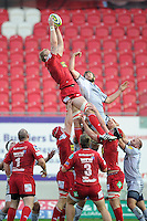 Damian Welch of Scarlets out jumps Geoff Parling of Leicester Tigers  during the LV= Cup first round match between Scarlets and Leicester Tigers at Parc y Scarlets (Photo by Rob Munro, Fotosports International)