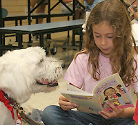 Gary Wilcox/staff....10/09/08...Seabreeze elementary school student Rachel Frank reads to Bently a member of the R.E.A.D. (Reading Education Assistance Dogs)  teams of Pawsitive Pets that was at Seabreeze elementary School at Jacksonville Beach.Thursday. (October 9, 2008)  R.E.A.D. (Reading Education Assistance Dogs) program is designed to improve the literacy skills of children through the assistance of registered Pet Partner¨ therapy teams as literacy mentors.