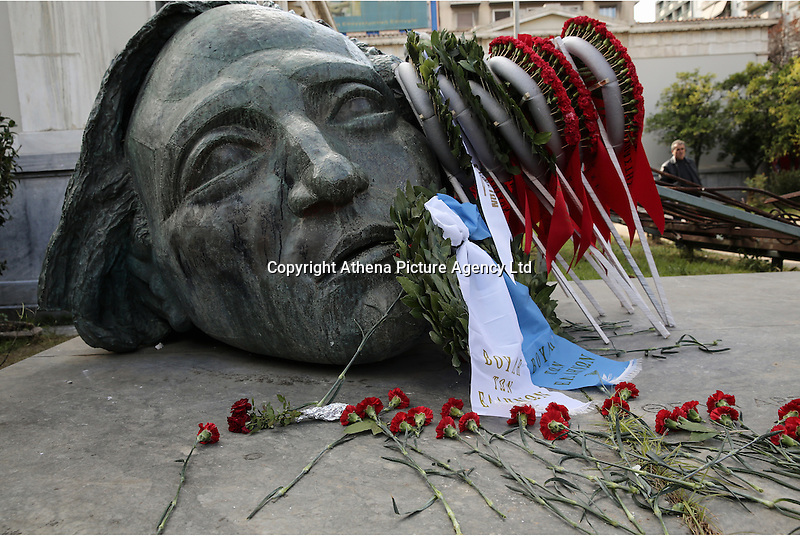 Pictured: Tributes left at the Athens Polytechinc in Athens Greece. Wednesday 16 November 2016<br /> Re: 43rd anniversary of the Athens Polytechnic uprising of 1973 which was a massive demonstration of popular rejection of the Greek military junta of 1967–1974. The uprising began on November 14, 1973, escalated to an open anti-junta revolt and ended in bloodshed in the early morning of November 17 after a series of events starting with a tank crashing through the gates of the Polytechnic.