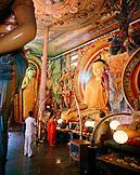 SRI LANKA, Asia, rear view of monk praying at Gangaramaya Temple