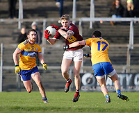 26th January 2020; TEG Cusack Park, Mullingar, Westmeath, Ireland; Allianz Football Division 2 Gaelic Football, Westmeath versus Clare; Luke Loughlin (Westmeath) holds on to the ball under pressure from Cian O'Dea and Eoghan Collins (Clare)