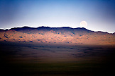 MONGOLIA, Gobi Desert, barren landscape under the setting full moon in the morning