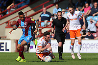 Blackpool's Jordan Thompson is fouled by Scunthorpe United's Funso Ojo<br /> <br /> Photographer David Shipman/CameraSport<br /> <br /> The EFL Sky Bet League One - Scunthorpe United v Blackpool - Friday 19th April 2019 - Glanford Park - Scunthorpe<br /> <br /> World Copyright © 2019 CameraSport. All rights reserved. 43 Linden Ave. Countesthorpe. Leicester. England. LE8 5PG - Tel: +44 (0) 116 277 4147 - admin@camerasport.com - www.camerasport.com