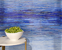 Ombre Tatami, a hand-cut jewel glass mosaic shown in Opal, Covellite, Delft, Iolite, Rhodolite, Sodalite, Lapis Lazuli, Ametrine, and Fluorite, inspired by an ombre watercolor, is part of the Broad Street™ collection.