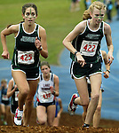 Jesuit's Noelle VanRysselberghe, left , watches her teammate Annamarie Maag's determination as she has her sights on Gresham's Khalia Tidwell, who lead most of way, to eventually won the 6A cross country championships at Lane Community College.
