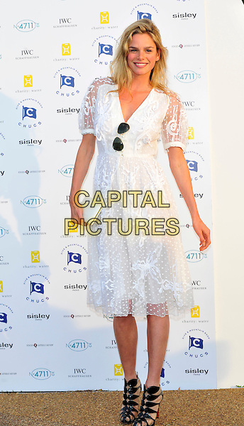 Natasha Gilbert.Attends Chucs Dive & Mountain Shop Swim Party in aid of charity: water at The Serpentine, London, England..July 4th, 2011.full length white sheer dress clutch bag black sandals sunglasses shades aviators .CAP/CJ.©Chris Joseph/Capital Pictures.