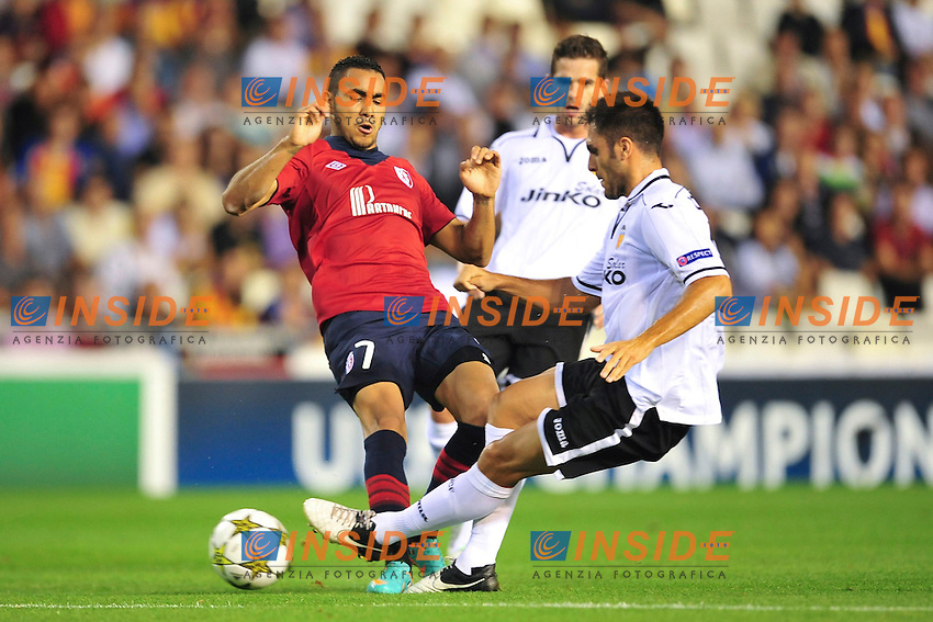 Victor Ruiz (Valencia) vs Dimitri Payet (Lille) .Valencia 2/10/2012.Football Calcio 2012/2013 Champions League.Valencia / Lille.Foto Panoramic/Insidefoto.ITALY ONLY