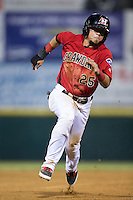 Carlos Arroyo (25) of the Hickory Crawdads hustles towards third base against the Charleston RiverDogs at L.P. Frans Stadium on August 25, 2015 in Hickory, North Carolina.  The Crawdads defeated the RiverDogs 7-4.  (Brian Westerholt/Four Seam Images)