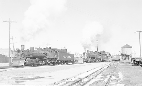 D&amp;RGW flanger/spreader train headed west on mainline in Antonito.  There is a flat car behind the spreader with a bulldozer on it.<br /> D&amp;RGW  Antonito, CO  Taken by Richardson, Robert W. - 2/20/1956
