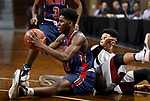 SIOUX FALLS, SD - MARCH 9:  Isaak Rowe #31 of Oklahoma Wesleyan looks to pass after retreiving a loose ball against IU East at the 2018 NAIA DII Men's Basketball Championship at the Sanford Pentagon in Sioux Falls. (Photo by Dick Carlson/Inertia)