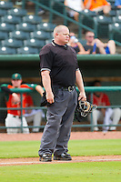 Home plate umpire Kevin Morgan between innings of the South Atlantic League between the Augusta GreenJackets and the Greensboro Grasshoppers at NewBridge Bank Park on August 11, 2013 in Greensboro, North Carolina.  The GreenJackets defeated the Grasshoppers 6-5 in game one of a double-header.  (Brian Westerholt/Four Seam Images)