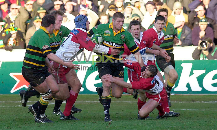 Pix:Ben Duffy/SWpix.com. International Club Rugby  Union...Heineken Cup Pool 6-Round 5....Northampton v Biarritz...11/07/2003...COPYWRIGHT PICTURE>>SIMONWILKINSON>>01943 436649>>..Northampton's Ben Cohen pushes away the tackle of  Biarritz's Mikael Etcheverria
