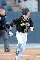 Right fielder Matt Ramsay (19) of the Wofford College Terriers runs toward first in a game against the Boston College Eagles on Friday, February 13, 2015, at Russell C. King Field in Spartanburg, South Carolina. Wofford won, 8-4. (Tom Priddy/Four Seam Images)