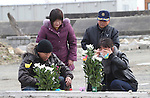 March 11, 2016, Tokyo, Japan - Relatives of tsunami victims offer prayers for the victims of tsunami and earthquake on the area destroyed by the tsunami at Namie in Fukushima prefecture near the crippled TEPCO's nuclear plant on Friday, March 11, 2016 on the fifth anniversary of the Great East Japan Earthquake and Tsunami.  (Photo by Yoshio Tsunoda/AFLO)
