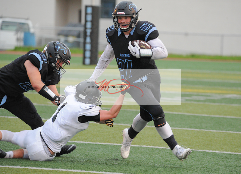 Derryk Snell avoids on a sweep against Service's Beck Stokes as the Mustangs' Jake Scholen draws a flag at p3 Chugiak High School Friday, August 19, 2016.  Photo for the Star by Michael Dinneen  Chugiak High School Friday, August 19, 2016.  Photo for the Star by Michael Dinneen